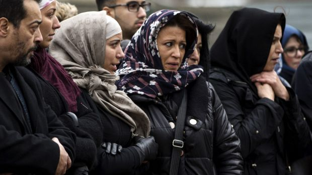 Mourners at the funeral of murdered police officer Ahmed Merabet at a Muslim cemetery in Bobigny, France.