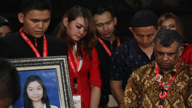 AirAsia CEO Tony Fernandes (right) attends a funeral ceremony for Khairunisa, a flight attendant onboard AirAsia flight ...