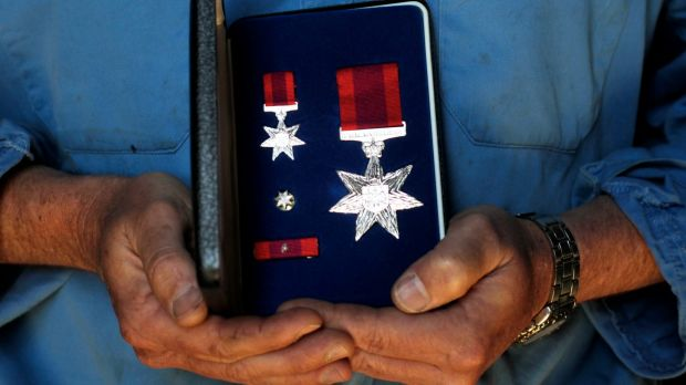 Lauren Munro, a Bali bombing survivor, holds his Star of Courage medal.