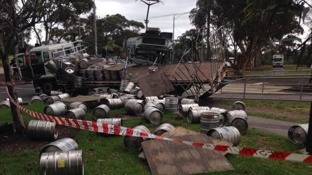 Carlton & United Breweries kegs were left strewn over the road and footpath.