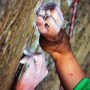 Kevin Jorgeson grips the surface of the Razor Edge during the climb.