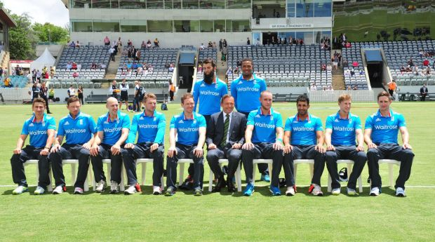 Centre, Prime Minister Tony Abbott during a team photograph with the England team.