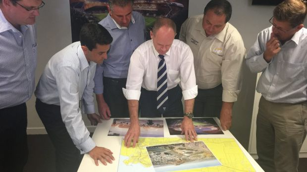 Premier Campbell Newman looks over plans for a new stadium in Townsville on Wednesday.