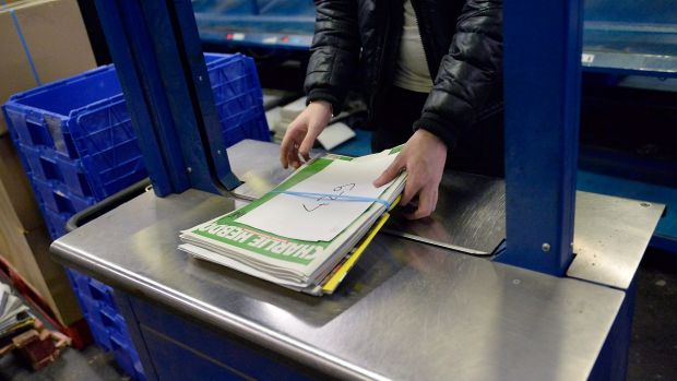 A worker prepares the new edition of <i>Charlie Hebdo</i> for delivery in Marne-la-Vallee, France.  Five million copies ...