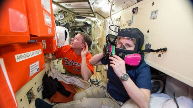 US astronaut Terry Virts, left, assists European Space Agency astronaut Samantha Cristoforetti with emergency training ...