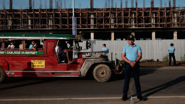 Prepared: Philippine National Police stand guard along the national highway during a security rehearsal ahead of the ...