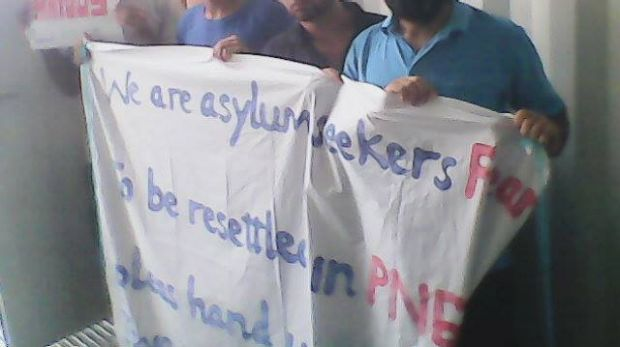 Asylum seekers at Manus Island stage a protest.