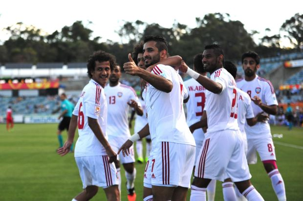 United Arab Emirates player Ali Ahmed Mabkhout celebrates his goal.