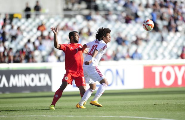 Bahrain player Abdulwahab Ali Alsafi and United Arab Emirates player Omar Abdulrahman in action.
