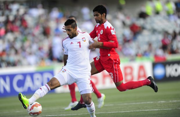 United Arab Emirates player Ali Ahmed Mabkhout and Bahrain player Mohamed Duaij Mahorfi in action.