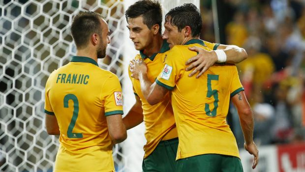 Wanted man: Tomi Juric (centre) celebrates his goal against Oman