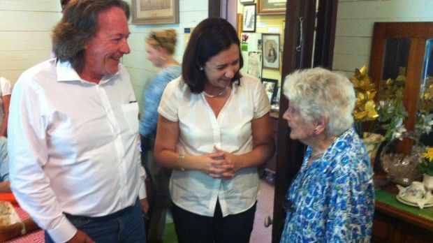 Charleville's Jane Houghton, 93, talks to Opposition Leader Annastacia Palaszczuk before playing her a song on piano.