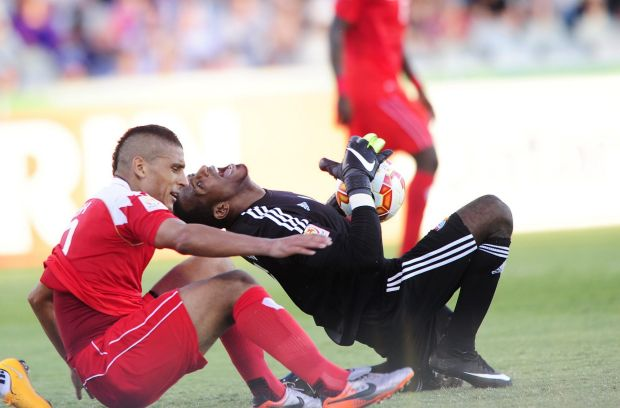 From left, Bahrain player Faouzi Aaish and United Arab Emirates goal keeper Majed Naser.