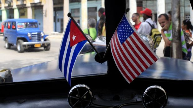 US President Barack Obama made good on a commitment to begin loosening economic sanctions against Cuba.