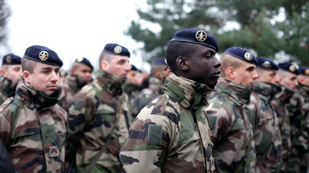French soldiers line up to listen to a speech by the  French Defence Minister Jean Yves Le Drian, at the Satory military ...