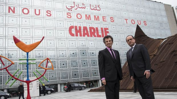 French President Francois Hollande (right) and the President of the Institut du Monde Arabe (Arab Institute), Jack Lang ...