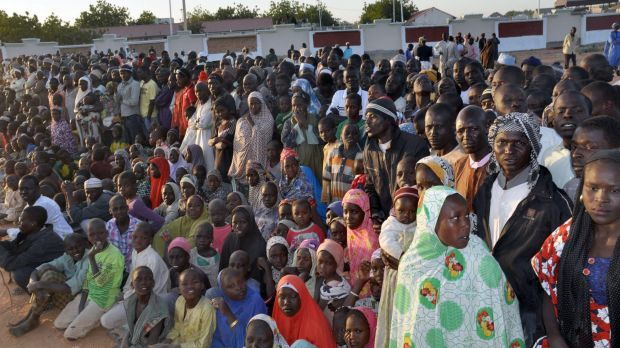 Displaced people from Baga listen to Nigerian President Goodluck Jonathan in a Maiduguri camp.