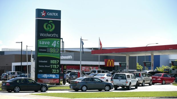 Cars line up for discounted fuel at Caltex/Woolworths Petrol in Majura Park.
