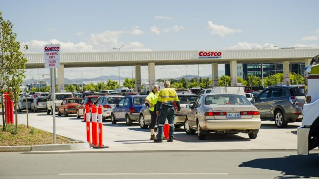 Cars crowd Costco at Majura Park on Thursday, as prices hit 95.7 cents per litre.