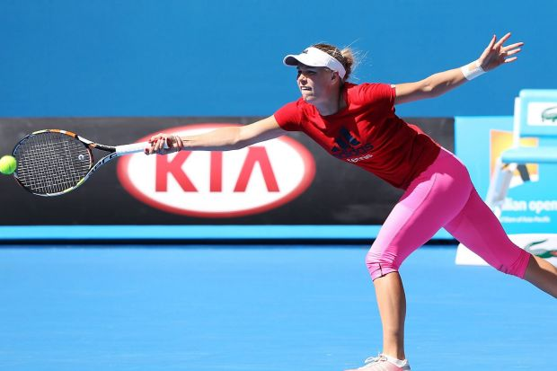 Caroline Wozniacki of Denmark hits a forehand during a practice session.