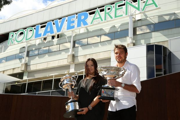 Li Na of China and Stan Wawrinka of Switzerland pose with the Daphne Akhurst Memorial Cup and the Norman Brookes ...