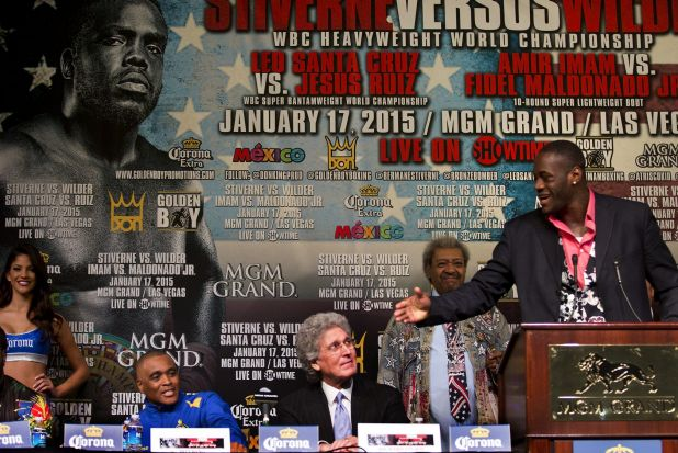 Contender Deontay Wilder, right, begins to take verbal shots at WBC heavyweight champion Bermane Stiverne, front left, ...
