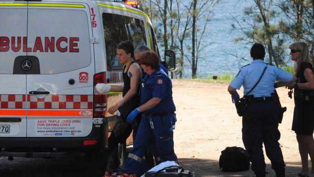 Paramedics with the injured teen at Mollymook.