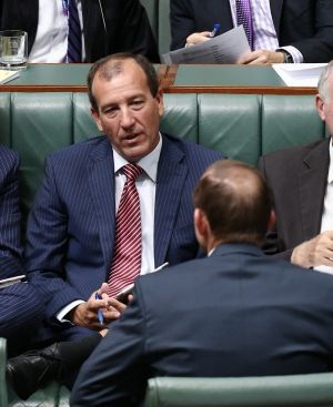 Mal Brough and Prime Minister Tony Abbott speak during a division of Parliament last year.