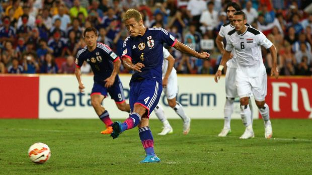 Keisuke Honda of Japan coverts a penalty against Iraq in Brisbane on Friday.
