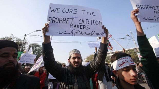 People chant slogans during a protest against Charlie Hebdo in Lahore on Thursday.