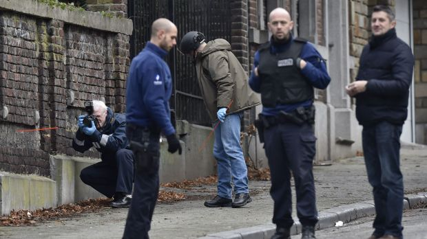 A forensic team members work at Colline street in Verviers, eastern Belgium, after police shot dead two suspects in a ...