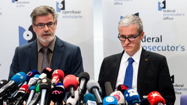 Over 13 raids in Belgium ... Belgian federal magistrates Eric Van Der Sypt, left, and Thierry Werts address the media on ...