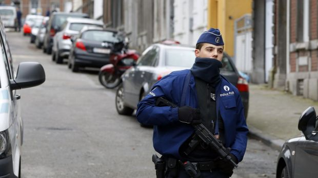 Belgian police block off the street outside an apartment in central Verviers, a town between Liege and the German ...