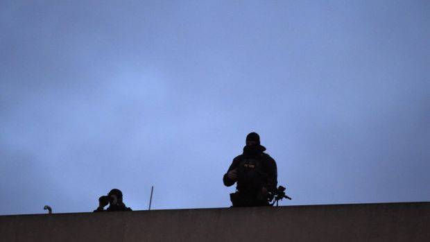 Two snipers of the police stand on the roof of a hotel opposite the French embassy in Berlin, where the German ...