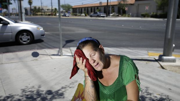 Amanda Ouellet wipes her face with a cold wet towel to cool off in Las Vegas on July 1, 2014.