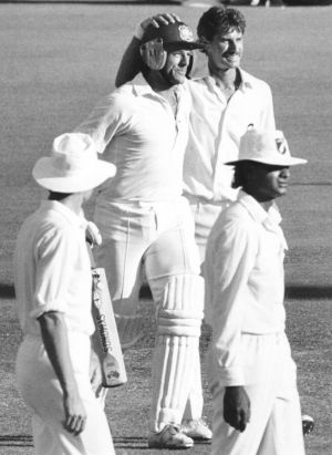 Mutual respect: Richard Hadlee congratulates Michael Whitney after he survived a spell by the champion fast bowler to ...