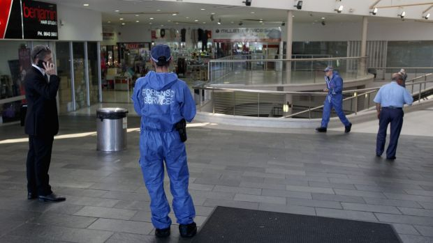 Police investigate a shopping centre in Auburn.