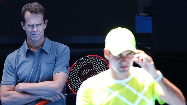 Coach Stefan Edberg watches on as Roger Federer practises.