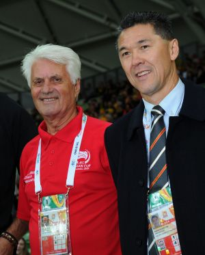 Davidson with former Socceroo Rale Rasic at the Asian Cup match between the Socceroos and Kuwait on January 9.
