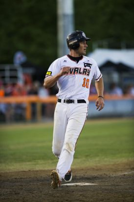 Mitch Walding crosses the home base.