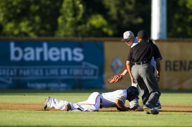 Anthony Allford dives for first base