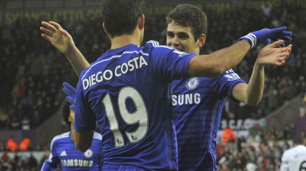 Blue tide: Oscar celebrates his second goal with Diego Costa.
