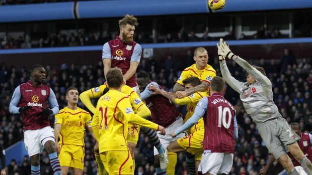 Hotly contested: Aston Villa defender Nathan Baker rises for a header in the Liverpool penalty box.