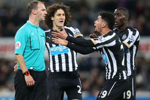Futile: Newcastle United's French striker Emmanuel Riviere pleads unsuccessfully with referee Robert Madley for a ...