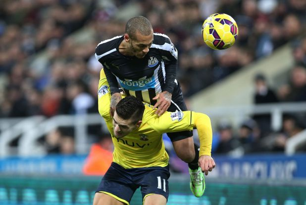 Piggyback: Southampton's Italian striker Graziano Pelle vies with Newcastle United's French striker Yoan Gouffran.