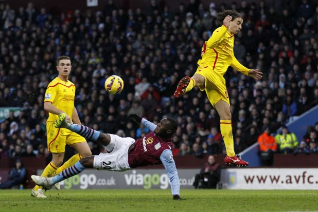 Aerial effort: Aston Villa's Congolese-born Belgian striker Christian Benteke has an unsuccessful shot defended by ...