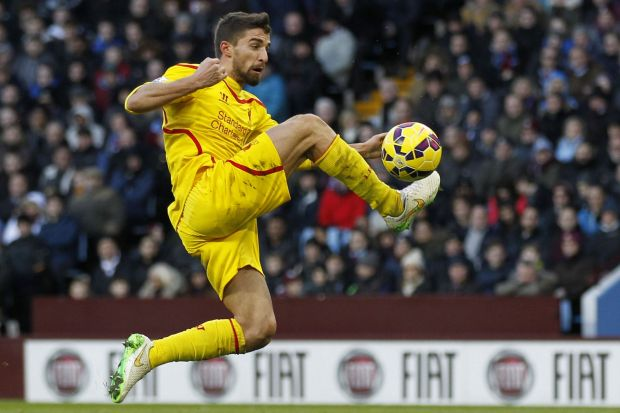 Bringing under control: Liverpool's Italian striker Fabio Borini prepares to shoot for the opening goal against Aston ...