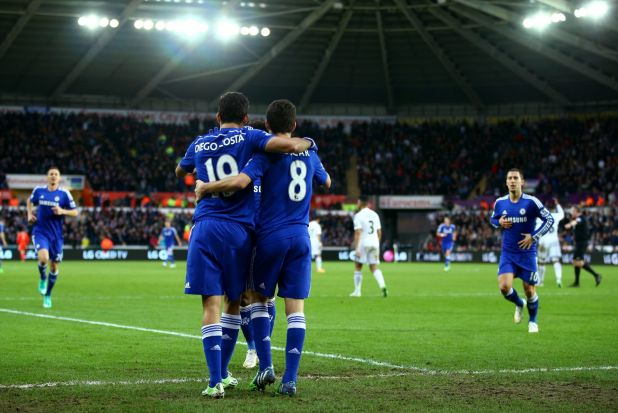 Love-in: Oscar and Diego Costa of Chelsea enjoy the team's fourth goal against Swansea City.