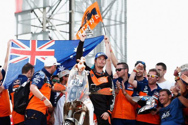 Proud Australian: Toby Price of the KTM Rally Factory Team celebrates his third place in the Dakar Rally with his team ...