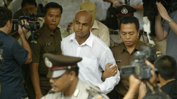 Myuran Sukumaran is escorted to court in Denpasar, Bali, in October 2005.